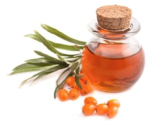 Small,Bottle,Of,Sea,Buckthorn,Oil,And,Berries,Isolated,On